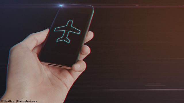 man-hand-holding-smartphone-with-airplane-icon-shutterstock-523917940-the7dew-3847